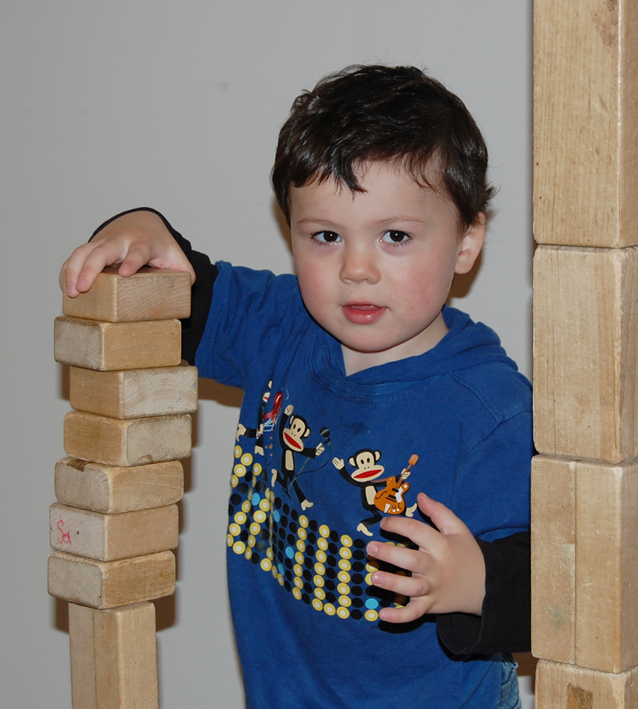 Children at Ashland Child Development have fun while learning with age-appropriate toys, such as blocks.