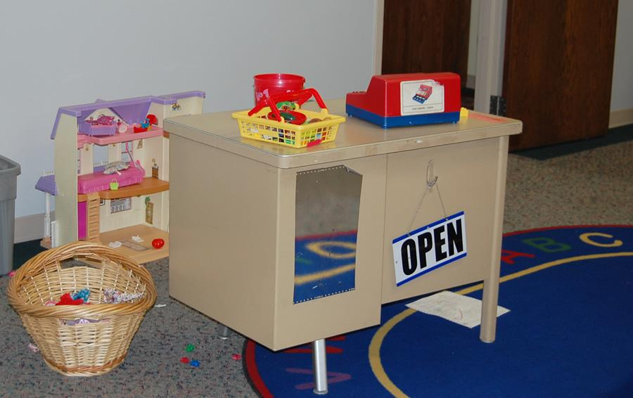Stations, such as our store area, lets children have fun while learning valuable skills.