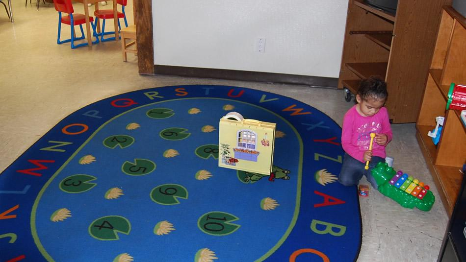 Two-year-olds can choose from a variety of stations, including the reading area.